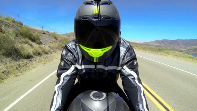 POV Man Riding Motorcycle Point of view shot of man riding motorcycle.  motorcycle stock videos & royalty-free footage
