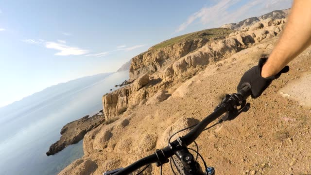 man riding mountain bike, cycling on rocks personal perspective view - cliffs stock videos & royalty-free footage