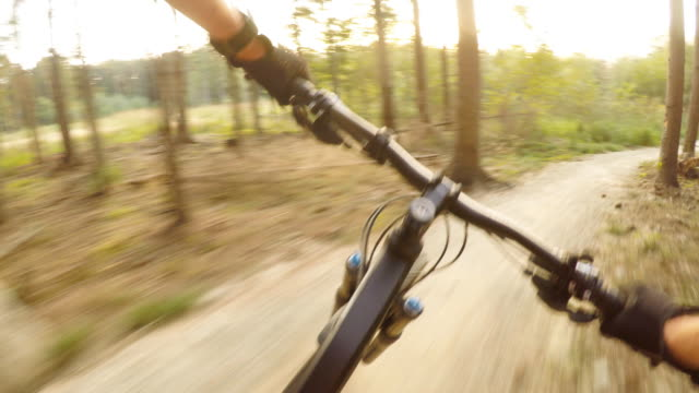 Man riding on mountain bike, cycling personal perspective view video