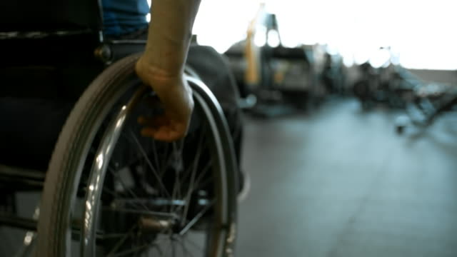 Man Riding Wheelchair in Gym video