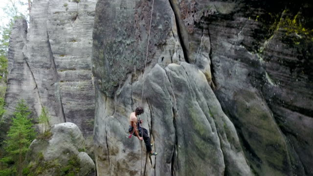 Man Rock Climber Rappelling video