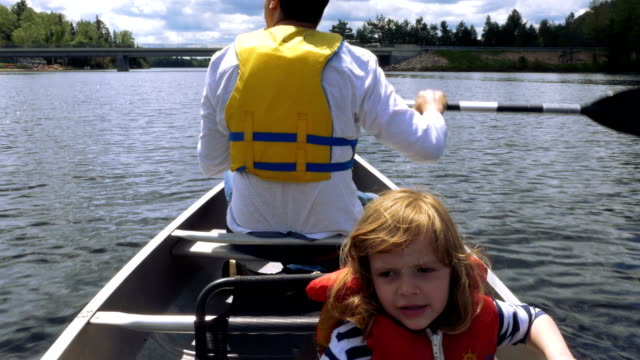 Man Rowing Around Cottage Country Ontario With Daughter on Board video