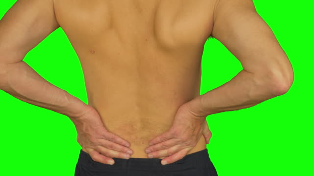 Man rubbing by palm his lower back due pain in back. Adult caucasian man back view. video