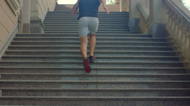 Man run up stairs in slow motion. Fitness man running upstairs video