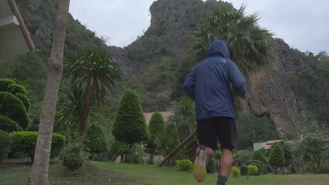 Man Running Alone At Valley Truck Shot