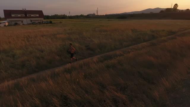 man Running at sunset - video