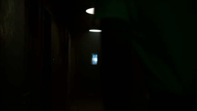 Man Running Away from Camera (Phantom 4k) Man wearing a white t-shirt runs away from camera through a dimly lit hallway in slow motion. action movie stock videos & royalty-free footage