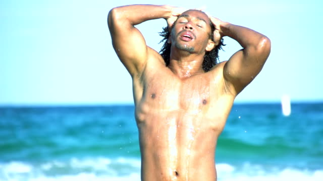HD SUPER SLOW MO: Man Running Hands Through Wet Hair HD720p: SUPER SLOW MOTION shot of a young muscular man running hands through wet hair while coming out of the sea. Florida sensualitet stock videos & royalty-free footage
