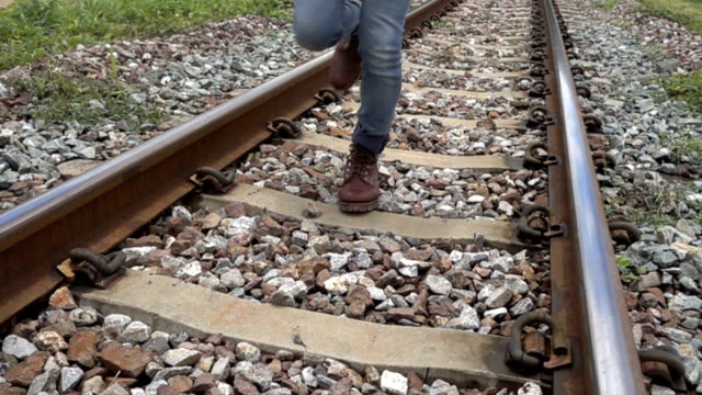 Man running on rail track to Camera 4k Slow Motion. Man running on rail track to Camera 4k Slow Motion. tramway videos stock videos & royalty-free footage