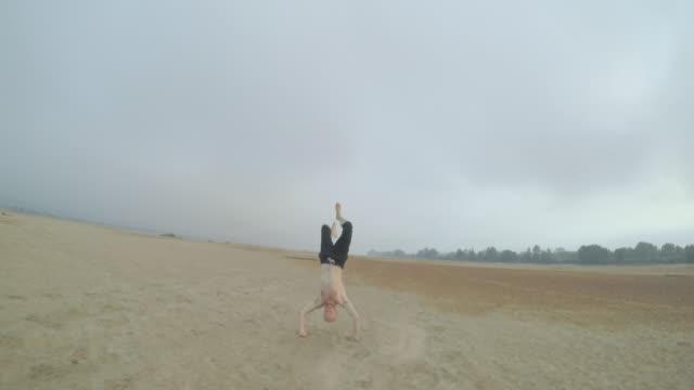 Man running on the beach video