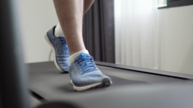 man running on treadmill cardio equipment. - runner rehab gym video stock e b–roll