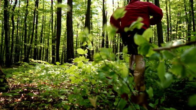 HD SUPER SLOW-MO: Man Running Through A Forest video