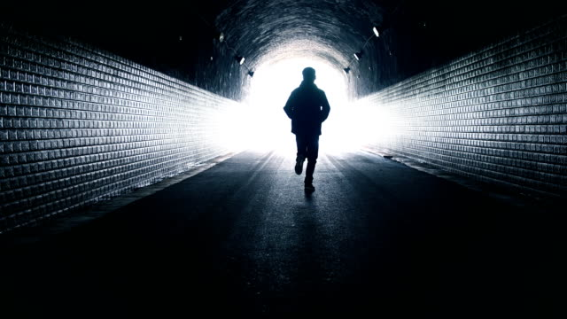 Man running toward light