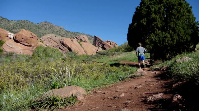 Man running Trading Post Trail Red Rocks Park Morrison Colorado Rocky Mountains video