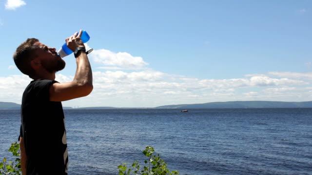 man runs near the river video