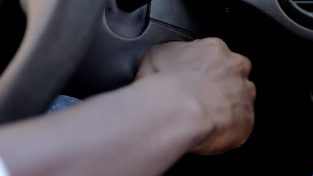 Man' s hands Starts Car With Key In The Ignition Then Turns It Off- close up Man' s hands Starts Car With Key In The Ignition Then Turns It Off- close up car key stock videos & royalty-free footage