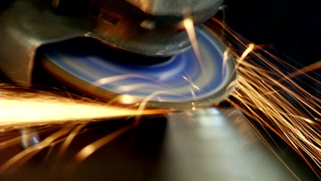 Man sawing metal by grinder video