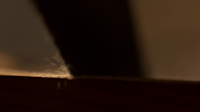 A man sawing wood Board with hand saw. Macro. Slow motion video