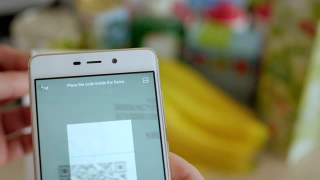 a man scans the qr code on a check from a supermarket. - scontrino video stock e b–roll