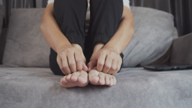 Man scratching on his itch feet.
