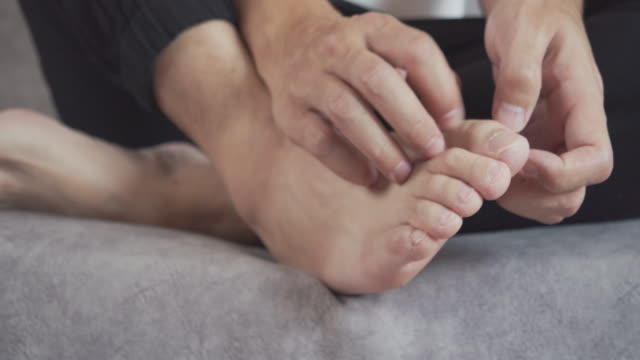 man scratching on his itchy foot.healthcare and medical concept. - dito del piede video stock e b–roll