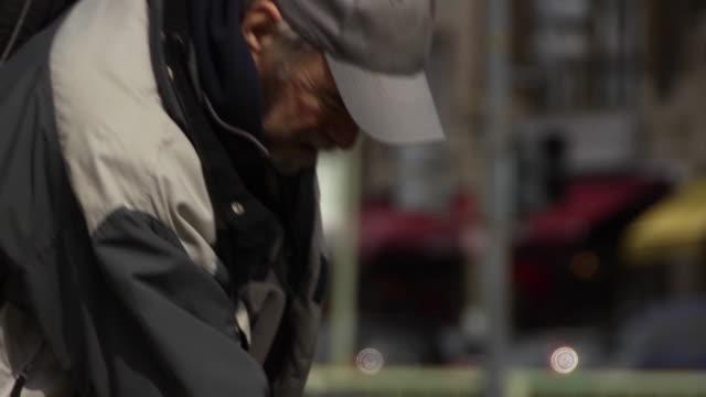 Man Searches in Trash Can - CU video