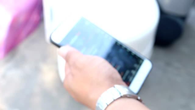 man searching internet with smartphone, blur shot - google стоковые видео и кадры b-roll