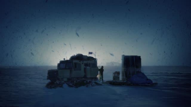 Man Secures Snowcat In Frozen Landscape
