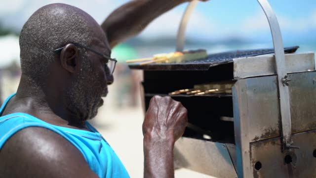 Man Selling curd cheese on the beach Active Seniors salesman stock videos & royalty-free footage