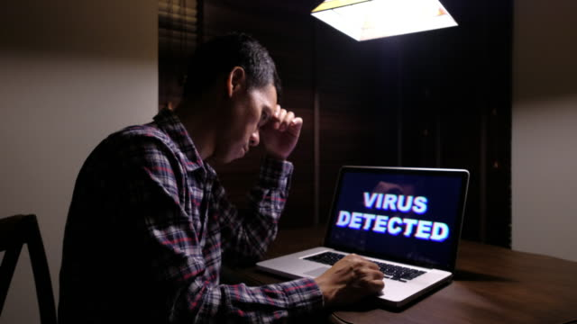 Man serious with Computer Virus detected video