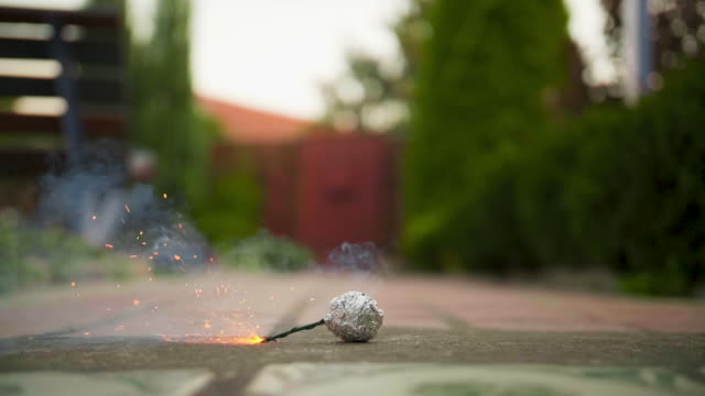 A man set fire a bomb in slow motion outdoors A man set fire a bomb in slow motion outdoors. firework explosive material stock videos & royalty-free footage