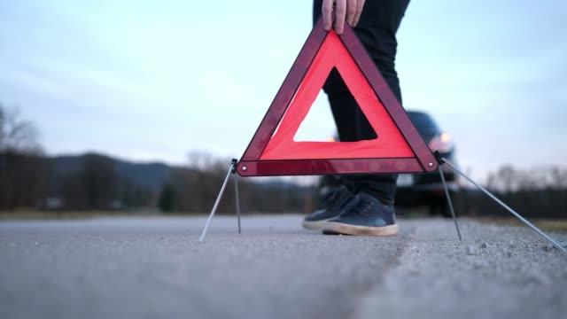 Man setting up warning triangle