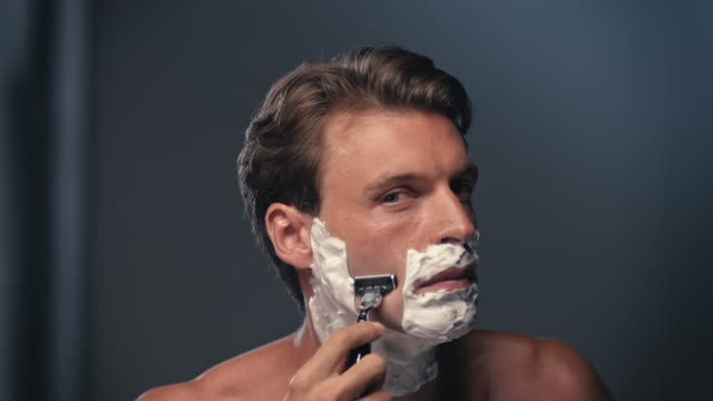 Man shaving his face video