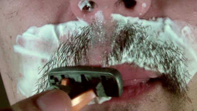 man shaving mustache video