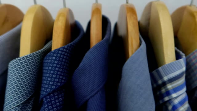 Man shirts on hangers - Stock video White, Blue and Red Classic Male Shirts button down shirt stock videos & royalty-free footage