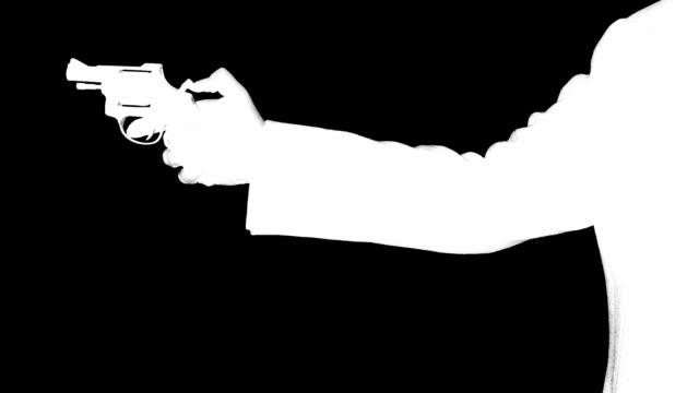 man shooting a handgun,real time,isolated,studio lighting - огнестрельное оружие стоковые видео и кадры b-roll