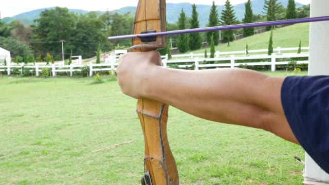 Man shooting arrow and shoot to centre target, 4k Resolution.