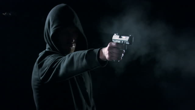 stockvideo's en b-roll-footage met man shooting with gun - gun shooting