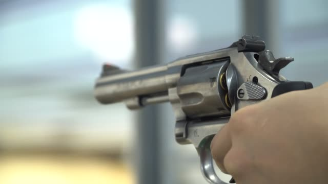 A Man shoots a Pistol Shooting a Weapon, Gun, Handgun, Exploding, Human Hand,Target gun stock videos & royalty-free footage