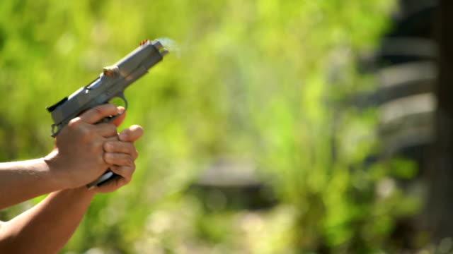 SLO MO - A Man shoots a Pistol