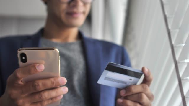 Man Shopping on Smart phone