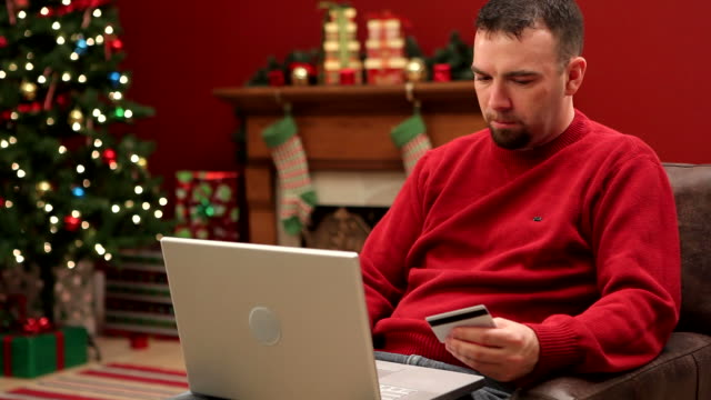 Man shopping online at Christmas video