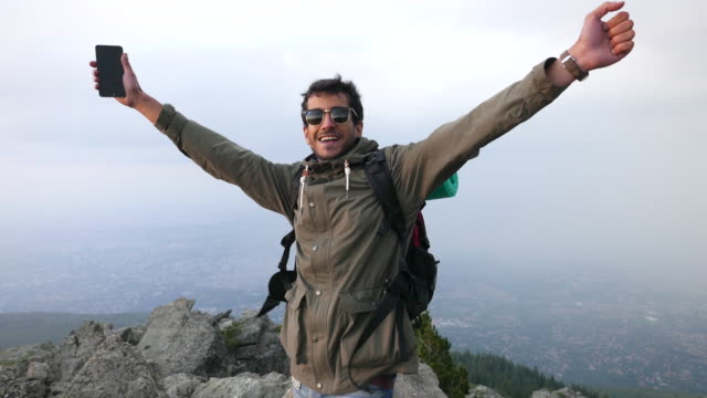 Man shouting happily after captivating the peak video