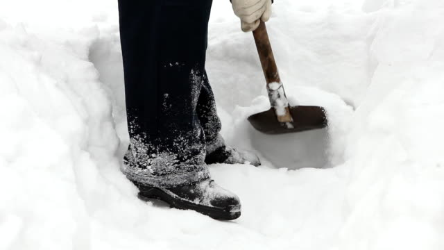 Man shoveling mass of snow video