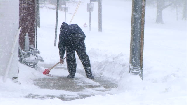 Man Shoveling Snow video
