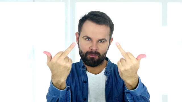Man Showing Middle Finger, Sitting in Office Man Showing Middle Finger, Sitting in Office middle finger stock videos & royalty-free footage