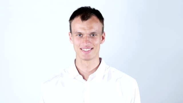 A man shows his hand hello video