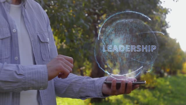 Man shows hologram with text Leadership