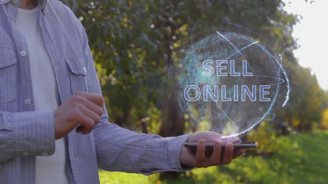Man shows hologram with text Sell online