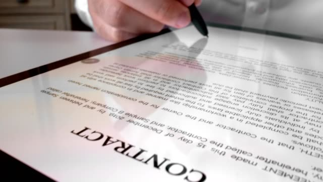 man sign signature on digital contract at tablet computer in close up view. - firma video stock e b–roll